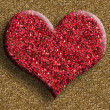 Photo: Red heart on golden background