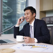 Stock Photo: Asibusinessman