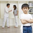 Asian boy and quarreling parents — Stock Photo