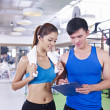 Young woman and her trainer — Stock Photo #35308193