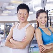 Young couple in gym — Stock Photo