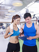 Young woman and her trainer — Stock Photo