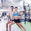 Man and woman exercising in gym — Stock Photo