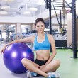 Young woman with fitness ball — Stock Photo