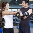Young couple working out in gym — Stock Photo