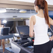 Stock Photo: Young womon treadmill