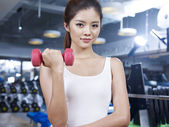 Girl in gym — Stock Photo