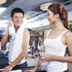 Man and woman on treadmill — Stock Photo #36482087
