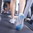 Stock Photo: Legs on treadmill