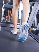 Legs on treadmill — Stock Photo