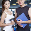 Man and woman in gym — Stock Photo