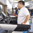 Overweight man exercising — Stock Photo