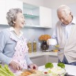 Stock Photo: Senior couple in kitchen