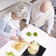 Senior couple chatting in kitchen — Stock Photo #37284869