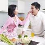 Asian couple in kitchen — Stock Photo #37822251