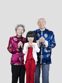 Senior couple and granddaughter — ストック写真