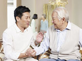 Senior father and adult son — Stock Photo