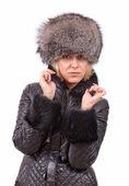 Blondine in eine Mütze und Jacke — Stockfoto