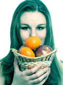 Teen and fruits basket — Stock Photo