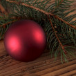 Red ball on fir branch — 图库照片