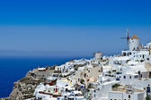 Windmill and white houses of Santorini — Stock Photo