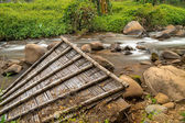 Remains of the roof  in the mountain river of  Thailand, Northen Thailand, Chiang Rai — Stock Photo