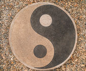 Yin-yang of the stones on the road — Stock Photo