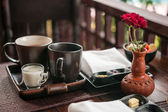 Light breakfast with tea, homemade jam and butter on wooden table — Stockfoto