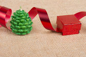 Holidays ornament with candle, ribbon and gift — Stock Photo