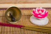 Candle, bell and  aromatherapy. Mat to Zen practice. — Stock Photo