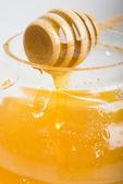 Drops of honey on the jar — Stock Photo
