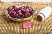 Spa and wellness setting with natural rosebuds — Stock Photo
