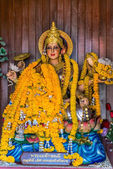 Statue of the Hindu goddess Parvati, a place of prayer, Wat Kaeo Manee Si Mahathat, Thailand — Stock Photo