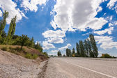Road  with cloudly sky in aegean region of Turkey — Stock Photo