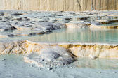 Carbonate travertines with blue water, Pamukkale, Turkey — Stock Photo