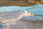 Carbonate travertines with blue water, Pamukkale — Stock Photo