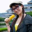 Girl eating corn — Stock Photo
