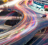 Traffic on junction in city — Stock Photo