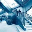 Low section of busy business people ascending on office stairs — Stock Photo