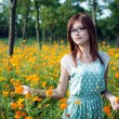 Young girl in a flower field — Stock Photo #19619303
