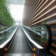 Moving escalator in an airport — Stock Photo #22348849