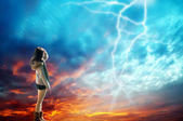 Girl looking at the lightning — Stock Photo
