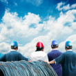 Back of workers with blue sky — Stock Photo
