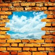 Porous wall to see the blue sky — Stock Photo
