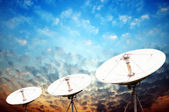 Satellite dish antennas under sky — Stock Photo