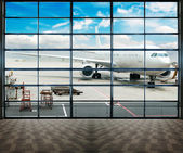 Parked aircraft on shanghai airport through the gate window. — Stock Photo