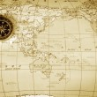An old brass compass on a Treasure map background — Stock Photo #26444447