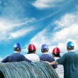 Back of workers with blue sky — Stock Photo #26453551