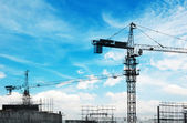 Building of a skyscraper with two tower cranes — Stock Photo