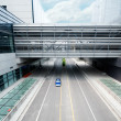 Road go through the modern office building at shanghai airport. — Stock Photo #27235437